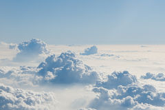 Blue sky above clouds. View of blue sky above fluffy clouds Royalty Free Stock Image