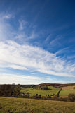 Blue sky above an English landscape in autumn. Big cloudy blue sky above an autumn landscape in Oxfordshire, England. Photo taken in late morning light. Space Royalty Free Stock Photography