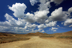 Blue sky above hill. Dark blue sky with white clouds on it Royalty Free Stock Images