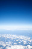 Blue sky above light clouds, Stock Image