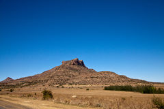 A blue sky above a mountain landscape Royalty Free Stock Photo