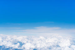 Blue sky above white fluffy cloud, cloudscape background with copy space Stock Photography