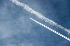 Blue sky with aeroplane and his footpring royalty free stock photos