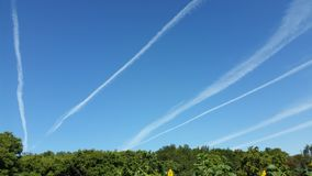 Blue sky with airlines trails royalty free stock photography