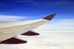 Blue sky and airplane wing. Viewing from a plane Royalty Free Stock Photo