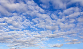 Blue sky all in Cumulus clouds Stock Image