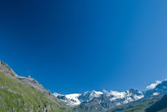 Blue sky in the alps. Its very beautiful to see the contrast between the blue sky of a sunny day and the white mountain peaks of the alps Royalty Free Stock Photo