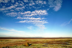 Blue sky and altocumulus clouds over Morecambe Bay Royalty Free Stock Image