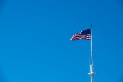 Blue sky and the American Flag Royalty Free Stock Images