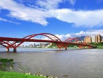 Blue sky and arch bridge. Near riverside stock photo