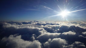 Blue Sky atmosphere and sun flare. Over the cloud, taken on the jet plane windows Stock Images