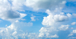 Blue sky background. With tiny clouds stock image