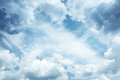 Blue sky background as frame with cumulus clouds Stock Photos