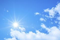 Blue sky background with the bright sun Stock Photo