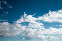 Blue sky background with brush strokes clouds.  Stock Photography