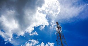 Blue sky on the background The cell phone tower is used to send Royalty Free Stock Photo