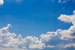 Blue sky background with clouds in bright sunny summer day Stock Photo
