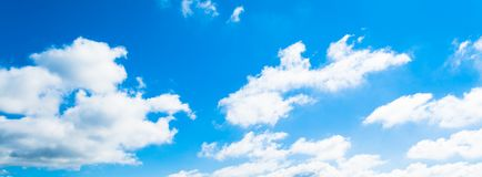 Blue sky background with clouds. In clear day, light, white, nature, beautiful, color, bright, heaven, air, weather, high, beauty, fluffy, environment, summer royalty free stock photography