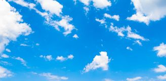 Blue sky background with clouds. In clear day, light, white, nature, beautiful, color, bright, heaven, air, weather, high, beauty, fluffy, environment, summer stock photography