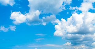 Blue sky background with clouds. In clear day, light, white, nature, beautiful, color, bright, heaven, air, weather, high, beauty, fluffy, environment, summer stock photos