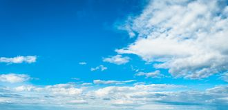 Blue sky background with clouds. In clear day, light, white, nature, beautiful, color, bright, heaven, air, weather, high, beauty, fluffy, environment, summer stock photo