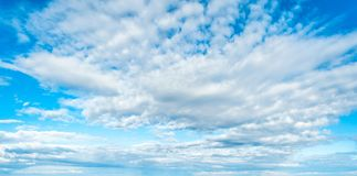 Blue sky background with clouds. In clear day, light, white, nature, beautiful, color, bright, heaven, air, weather, high, beauty, fluffy, environment, summer royalty free stock photo