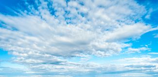 Blue sky background with clouds. In clear day, light, white, nature, beautiful, color, bright, heaven, air, weather, high, beauty, fluffy, environment, summer stock images
