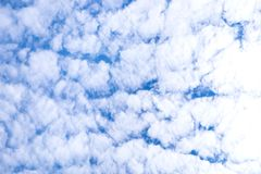 Blue sky background with clouds and light of the sun stock photo