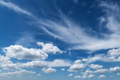 Blue sky background with clouds. Stock Images
