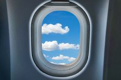Blue sky background with clouds view from airplane window. Royalty Free Stock Image