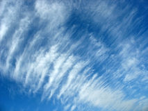 Blue sky background with fleecy clouds Stock Photos