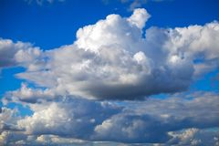 Blue sky background. With fluffy clouds royalty free stock image