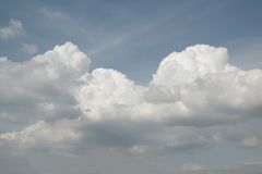 Blue sky background with fluffy clouds. Stock Images