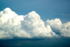 Blue sky background with fluffy clouds. Stock Image