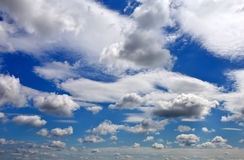 Blue sky background with fluffy and tiny clouds. Stock Photo