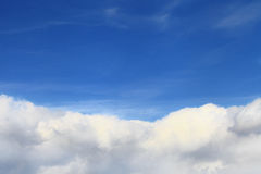 Blue sky background over white clouds Royalty Free Stock Images