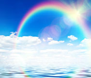 Blue sky background with rainbow Royalty Free Stock Images