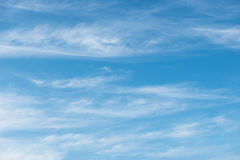Blue sky background with soft clouds Stock Photography