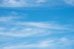 Blue sky background with soft clouds Stock Photo