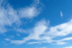 Blue sky background. With some clouds showing high altitude cirrus, cirrostratus and some cirrocumulus Stock Photography