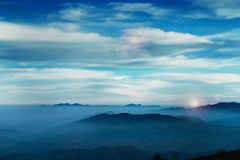 Milky cloud on sky  at sunrice time from highest mountain stock photography