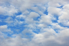 Blue sky. Background with tiny clouds Royalty Free Stock Images