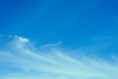 Blue sky background with tiny clouds. Royalty Free Stock Image