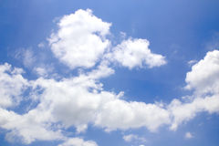 Blue sky background with tiny clouds. Stock Photo