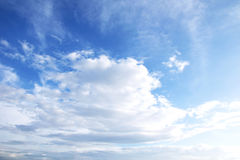 Blue sky background with tiny clouds. Royalty Free Stock Photo