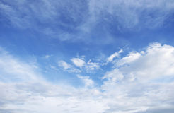 Blue sky background with tiny clouds. Stock Image