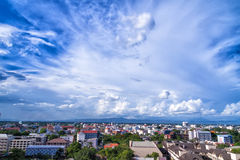 Blue sky background with tiny clouds and cityscape Royalty Free Stock Photos