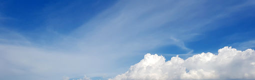 Clouds in the blue sky. Blue sky background with tiny clouds Royalty Free Stock Image