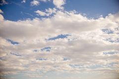 Clouds and blue sky background. Blue sky background with tiny clouds, Clouds and blue sky background, flying plane royalty free stock image