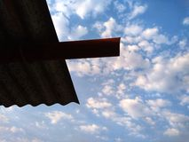 Blue sky background with tiny clouds and roof. stock photos
